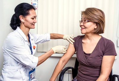Doctor giving an injection to a patient