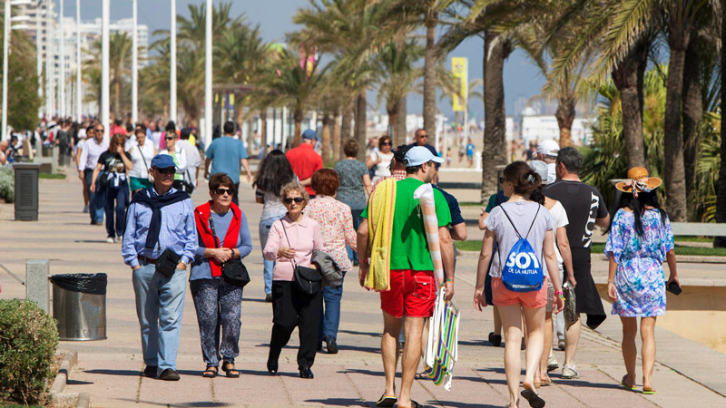 People walking on Gandia's promenade sea