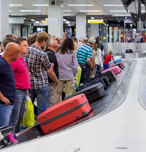 Travelers waiting for their luggages