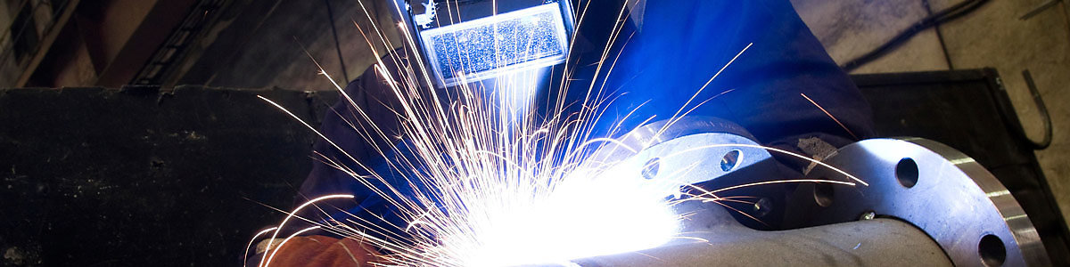 Industrial arc welder at work