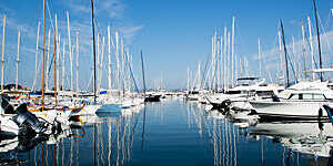 Harbor with yachts and sailboats in Saint Tropez, France.