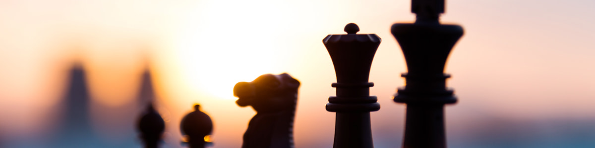 Game of chess and sunset in the background