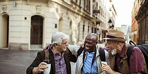 Close up of a group of male senior tourists exploring the city.