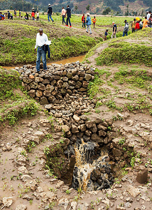 People visiting a stormwater drainage project in Rwanda