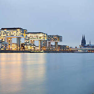 Cologne Cathedral and Rheinau Harbor at night