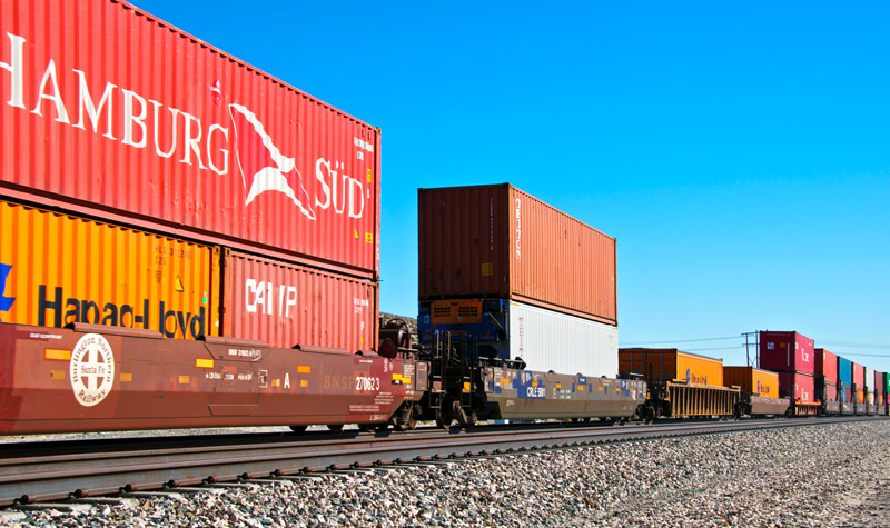 Railroad train freight container carrier