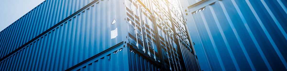 Close-up of blue cargo containers.