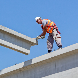 Worker on a concrete joist.