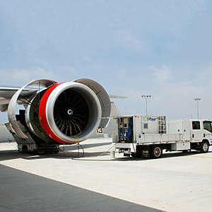 An EcoPower truck washing an airplane.