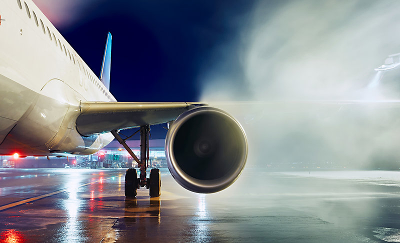 Deicing an airplane.