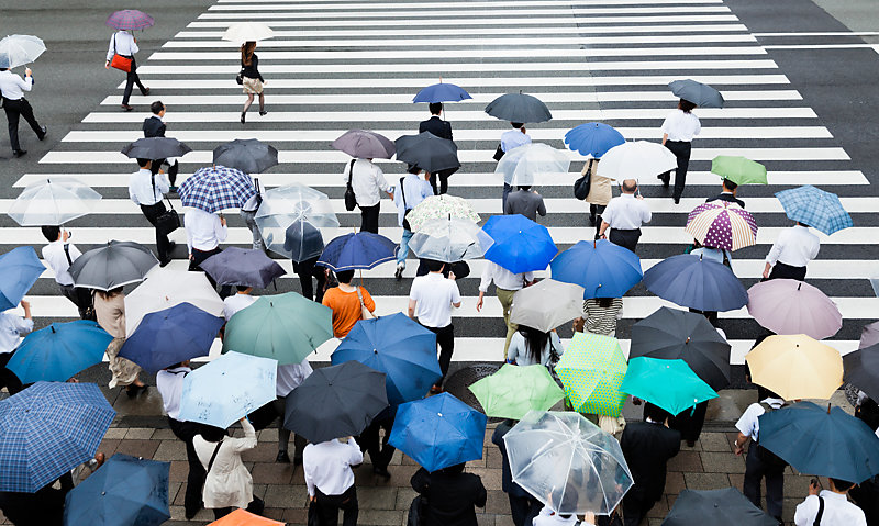 Crosswalk scene on a rainy day in Tokyo, Japan.