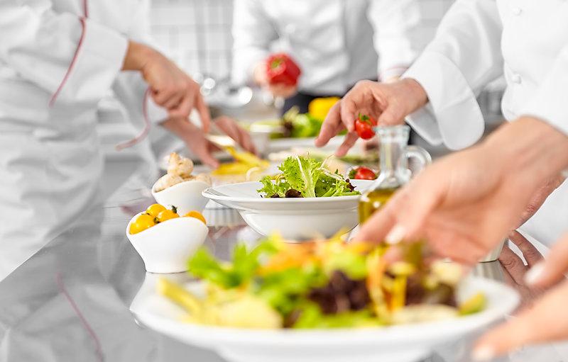 Chefs preparing salads.