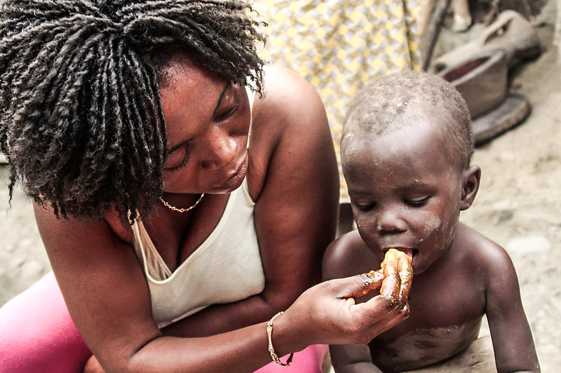 Ghanaian mother feeding her child.