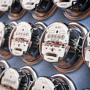 Row of electric meters, measuring power use.