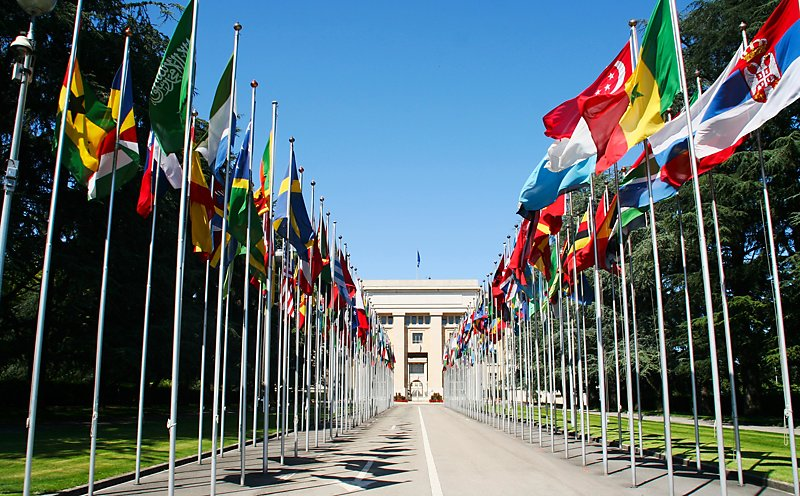 Row of flags at the entrance of the United Nations building in Geneva, Switzerland.