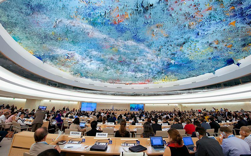 Meeting room of the United Nations Human Rights Council with its unique ceiling painting.
