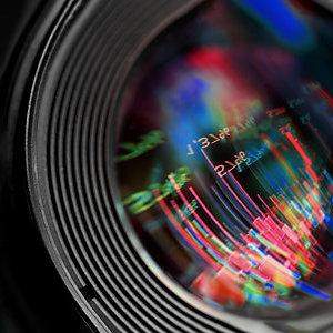 Abstract graphics reflected in a camera lens.