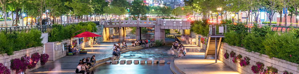 People relaxing by Cheong-Gyecheon stream in the centre of Seoul.