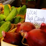 A variety of locally grown organic farmer's market vegetables are on display for sale.