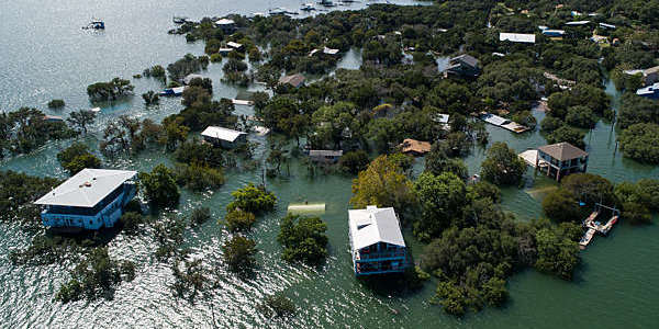 Aerial view of houses under water after a major flood.