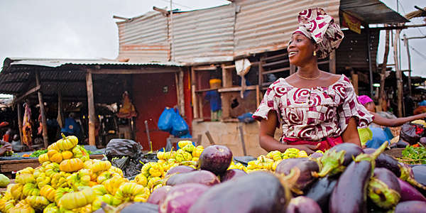 African woman selling vegetables on the market in Bamako, Mali.