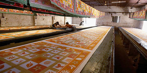 Workers making silk screen-printed textiles in Sanganer, India.