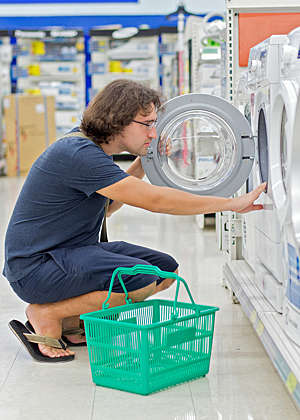 Man shopping for a washer and dryer.
