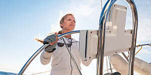 Female skipper sailing on sailbot, copy space