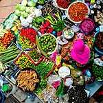 High angle view of vendor selling vegetables at market.