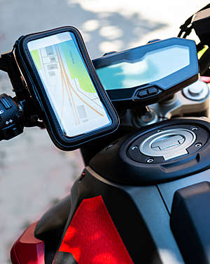 Close-up of a navigation tablet on a motorcycle.