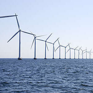 Row of wind turbines at sea off the coast of Copenhagen, Denmark.