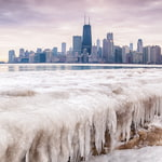 Frozen Lake Michigan and city skyline in Chicago, USA.
