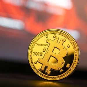 Close-up view of a gold-coloured Bitcoin.