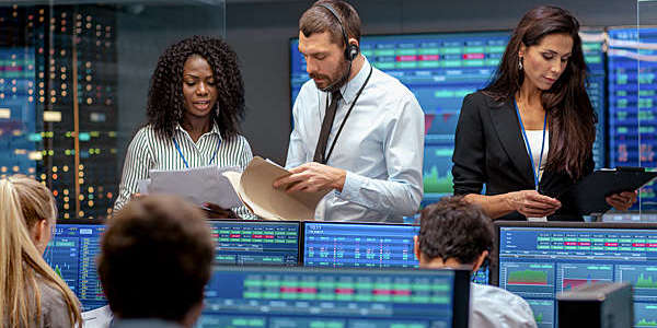 People looking busy in a corporate trading room.