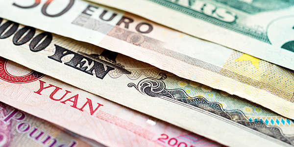 Close-up of international currency notes.