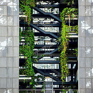 Vegetation grows out of the different levels of a plant-covered building in Barcelona, Spain.