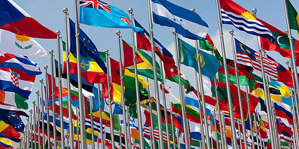 National flags of different countries blowing in the wind.