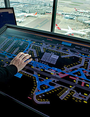 Air traffic controller's hand on ramp departure console.