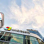 Close low-angle view of Microsoft logo on office building-
