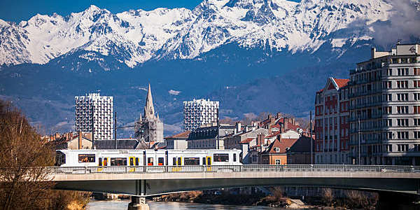 Shot of Grenoble's city centre backed by the Belledonne mountain range.