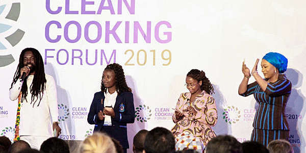 Four African people, including Samira Bawumia, the Second Lady of Ghana, and Grammy-nominated artist Rocky Dawuni, lined up at the Clean Cooking Forum 2019 in Nairobi, Kenya.