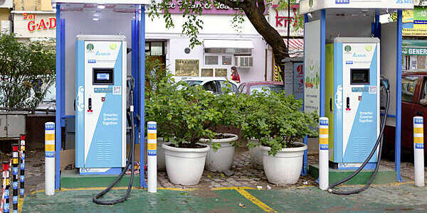 Two electric vehicle charging stations at a parking lot in New Delhi's Khan Market, India.