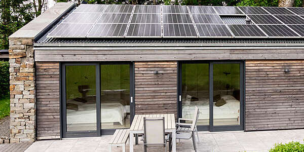 Detached house with solar panels on the roof.