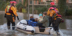 Family being rescued by the fire service after the River Derwent burst it's banks in the village of Old Malton England.