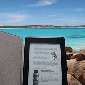 Portable e-book brought at the beach,