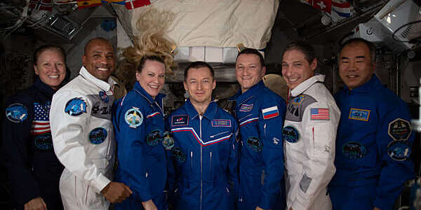 Line-up of the Expedition 64 crew. From left: NASA astronauts Shannon Walker, Victor Glover and Kate Rubins; Roscosmos cosmonauts Sergey Ryzhikov and Sergey Kud-Sverchkov; NASA astronaut Michael Hopkins; and JAXA astronaut Soichi Noguchi.