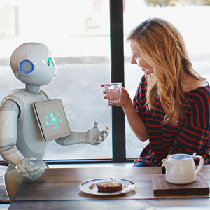 Pepper the robot and a young woman chatting