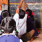 Children in a classroom at lesson, in a rural school of India.