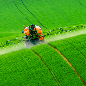Tractor spraying chemicals