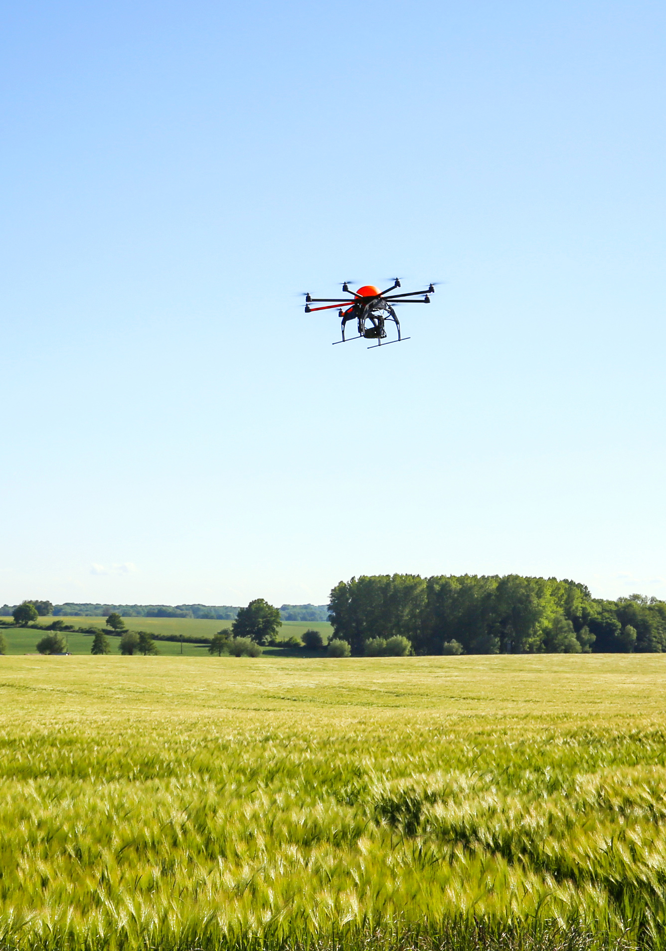 Drone flying in an open field